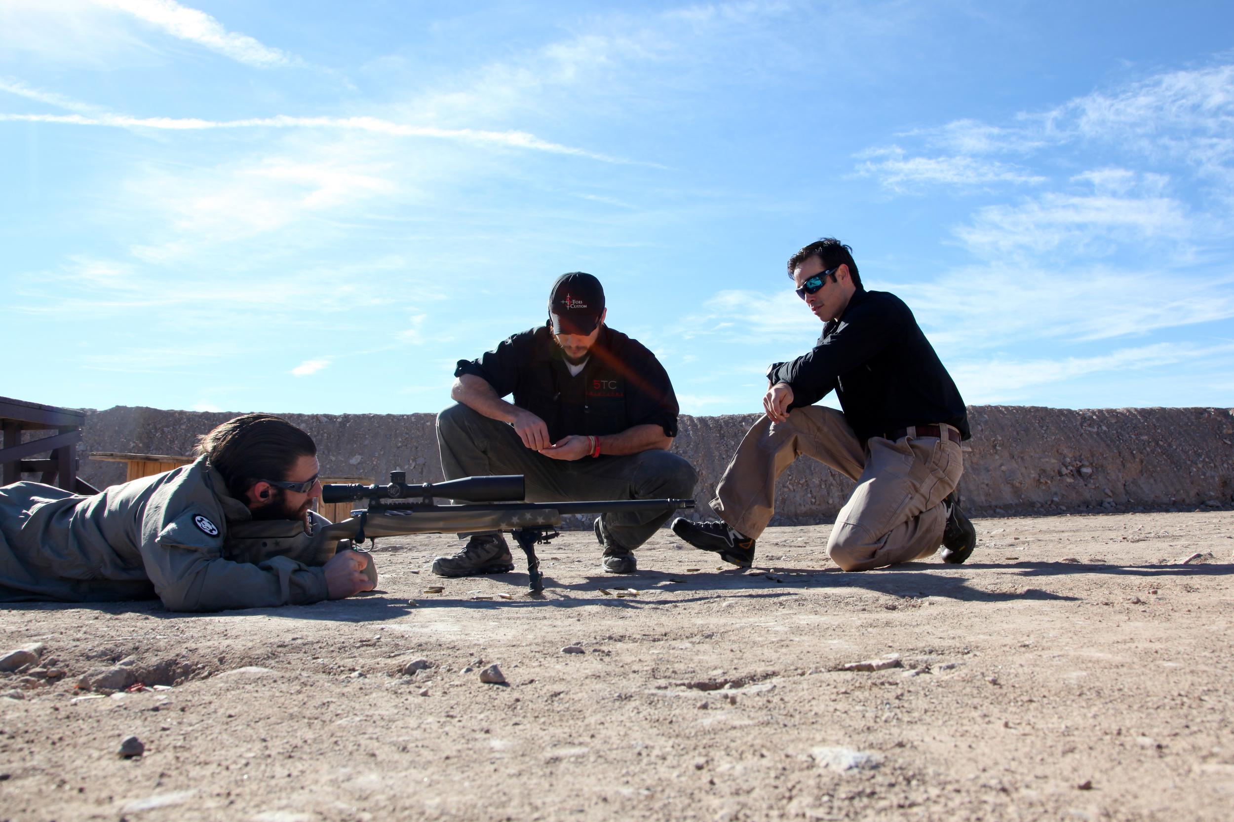 Nick working with Brady and John Wayne of  5 Toes Custom  on the Long Gun.