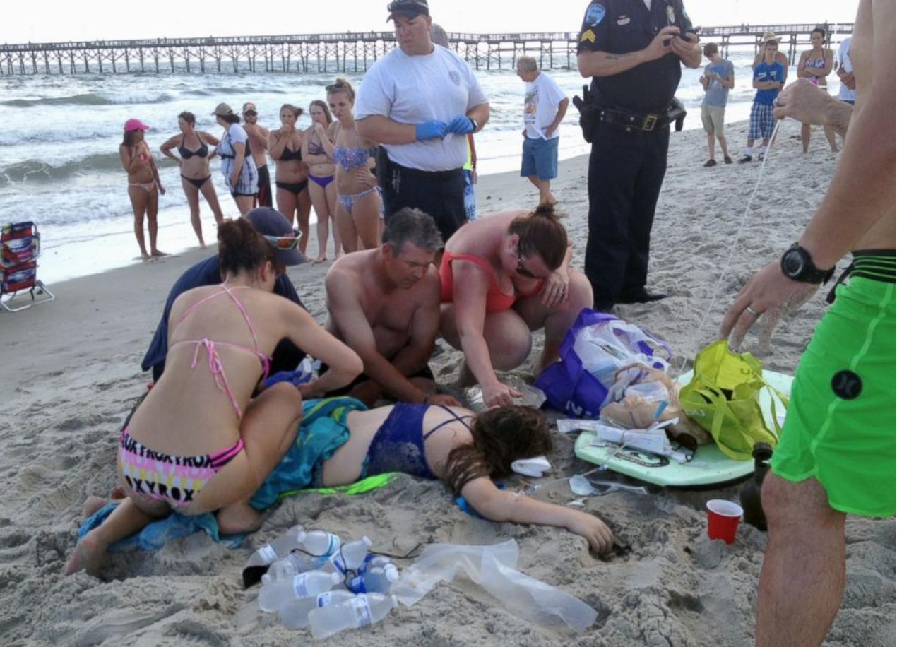 PHOTO: Emergency responders assist a teenage girl at the scene of a shark attack in Oak Island, N.C., Sunday, June 14, 2015  Steve Bouser/The Pilot, Southern Pines, N.C. via AP