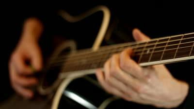 stock-footage-male-hands-play-on-acoustic-guitar.jpg