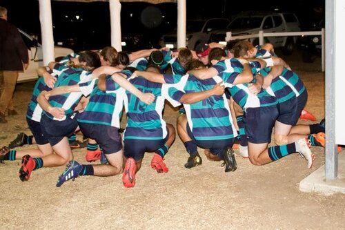 The FLC Open team praying before a game.