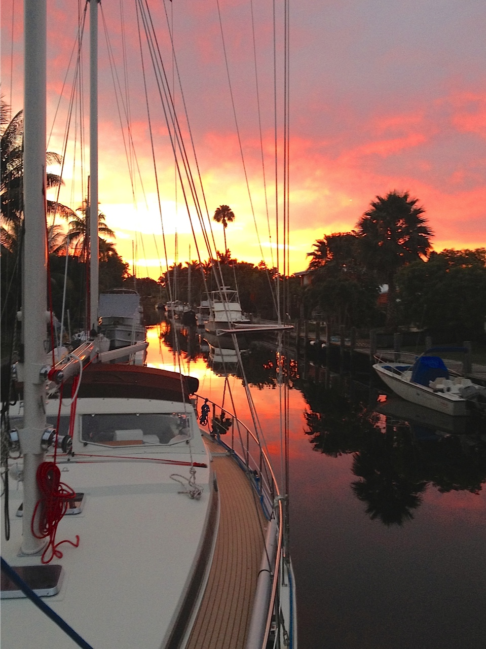 Fort Lauderdale is filled with canals like the canal between Orange Isle street and Tangelo Isle street. 31 March 2014, 7:45 PM.