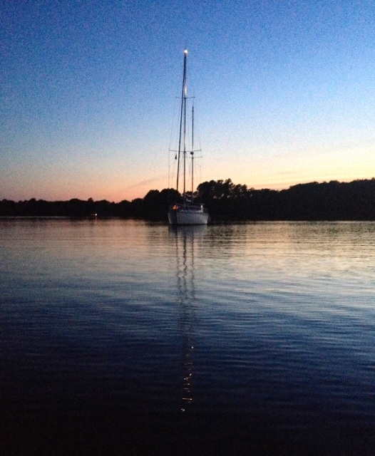 Note the reflection of the mast lights on the water. Corrotoman river, 9:04 pm, 5 July 2014. iPhone 4S.