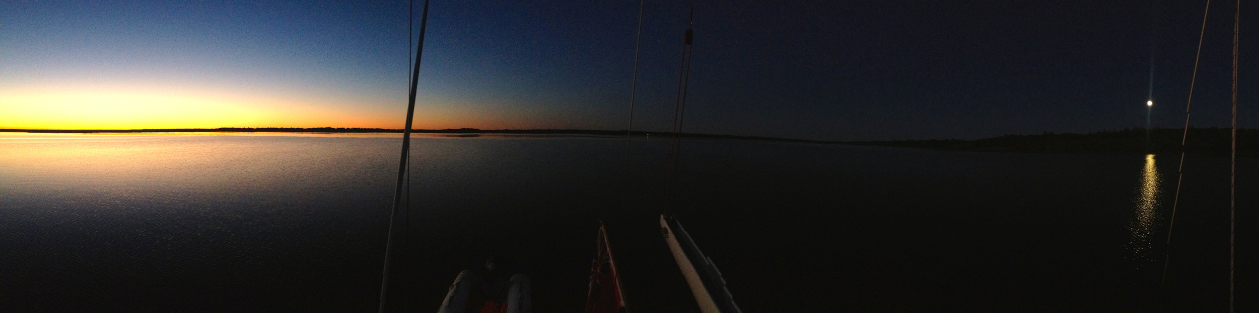 "Simultaneous panorama picture of sunset and moonrise (a bit over 180° field of view), from  Peregrinus  aft deck; the slanting lines are the boat's backstays.  8:17 PM, 8 September 2014, Mouth of the Salmon river, Grand Lake.  iPhone 4S, ISO 640, 1/120"", original 9365 pixels wide."