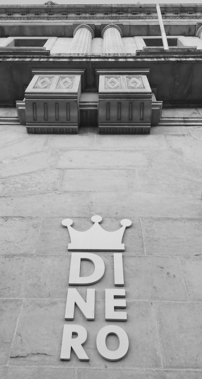 "Prominent metal sign right next to the main entrance of the massive 1925 Banco de España building in Santander.   Denarius  was the old 10 —"" deni "", or 'in tens'— Roman coin first issued by the Republic in 211 BC and last issued under Diocletian in 275 AD; reissued by Eastern Roman Empire as the Denarius Auri;  such long use ended up meaning ""money"" in the Med: Spanish  dinero , Poruguese  dinheiro , and Arab  dinar .  7 September, iPhone 6 Plus."