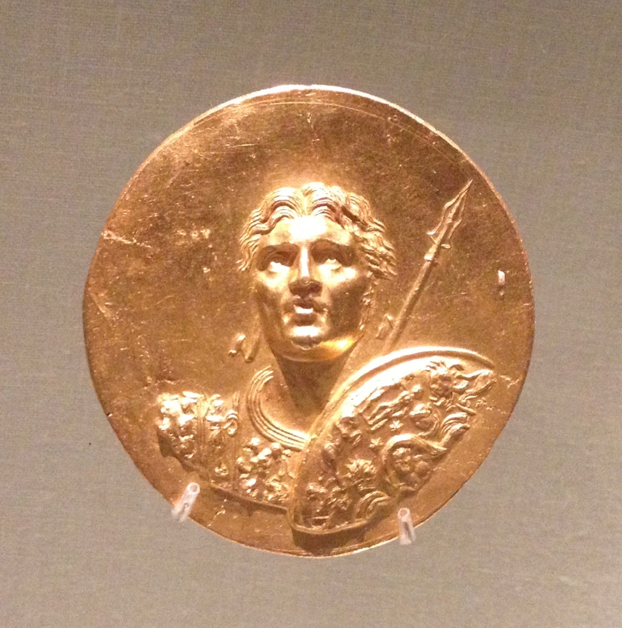 Memorial coin issued for the  Alexandreia  Games in Macedon during Roman times, sometime between 218 and 250 A.D.  Instead of the usual profile view, Alexander faces us while looking forward and upward.  Out of the 20 surviving coins, with various designs, Gulbenkian got eleven, and The Walters got three.  The games collectors play.  iPhone 4S, 19 October.