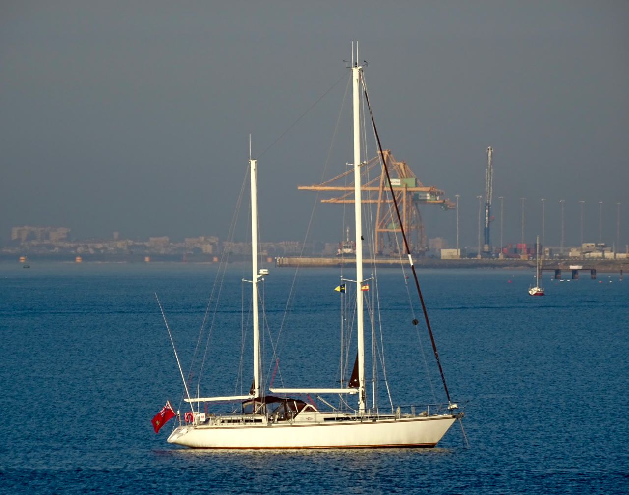 Peregrinus  at anchor in the Odiel river, in front of Mazagón Marina, mancomunidad of Moguer and Palos de la Frontera.  Photo courtesy of Javier Delgado.  Sony DSC-HX60V, 10:14 AM, 17 November 2015