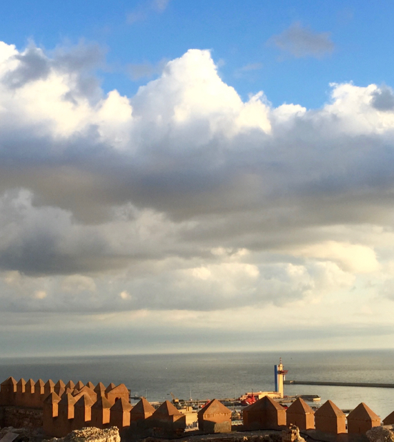 The tiny white mast in the very center of the picture is  Peregrinus  at anchor, as seen from the Alcazaba. iPhone 6 Plus.