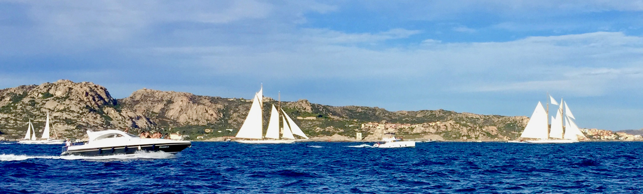 The entrance to Nelson Bay. In the background, La Maddalena island; on the right, the town of La Maddalena proper. iPhone 6 Plus, 5:50 PM, 16 August 2017.