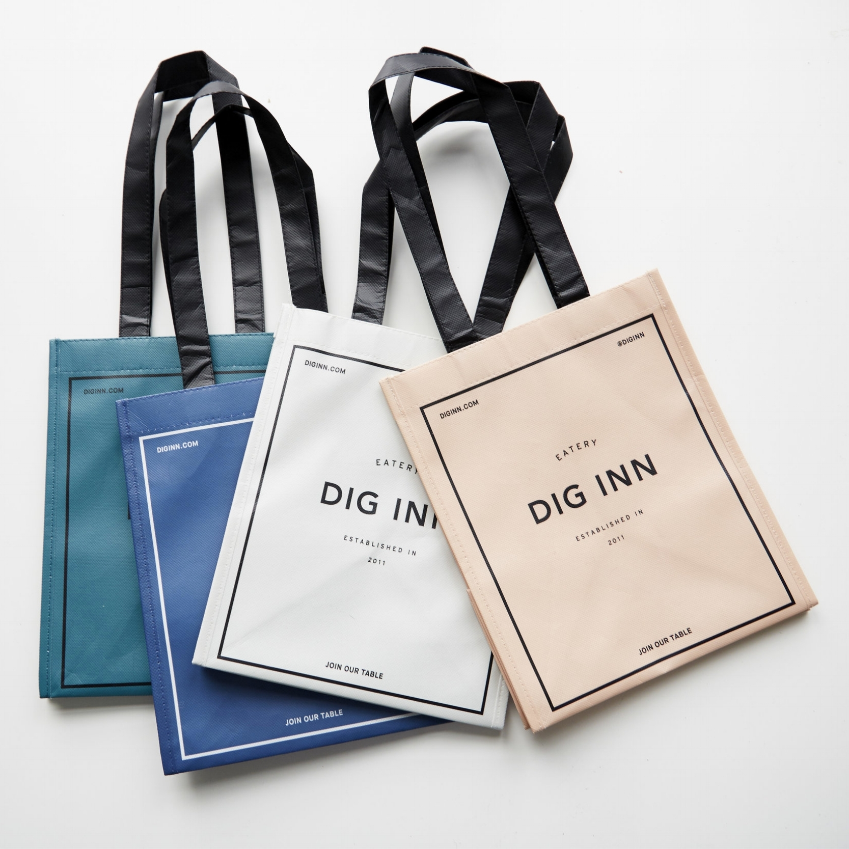 Dig Inn merchandise; bags.  Photo by Henry Hargreaves.