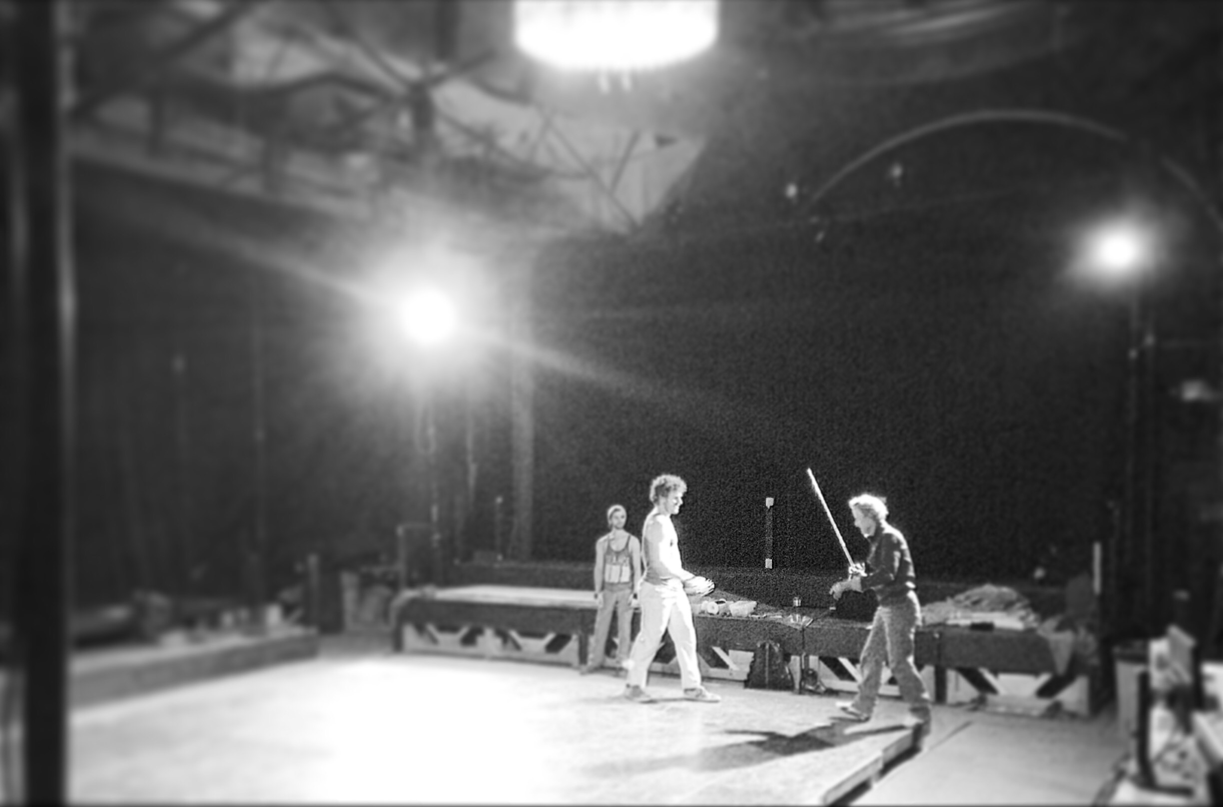 Ian Rose (far right) works with J. Connor Hammond and Ken Sandberg on the Musketeer stage