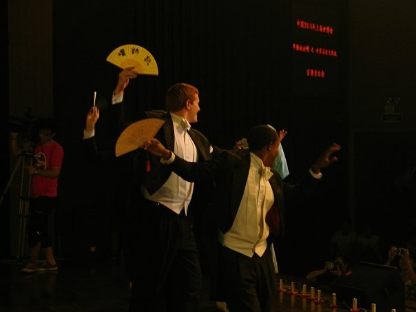 Learning a fan dance at the Shanghai World Expo