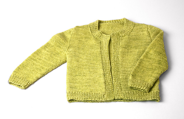 The Alpha B Basic Baby Cardigan by Knit Purl would look adorable knit in our yarn, even more so with a little yarnover buttonhole modification at the top of the placket!