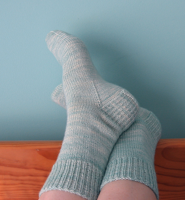 These Very Vanilla Socks by Jo-Anne Klim are the perfect simple sock, letting the fun colorway be the focus. It's available as a free Ravelry download.