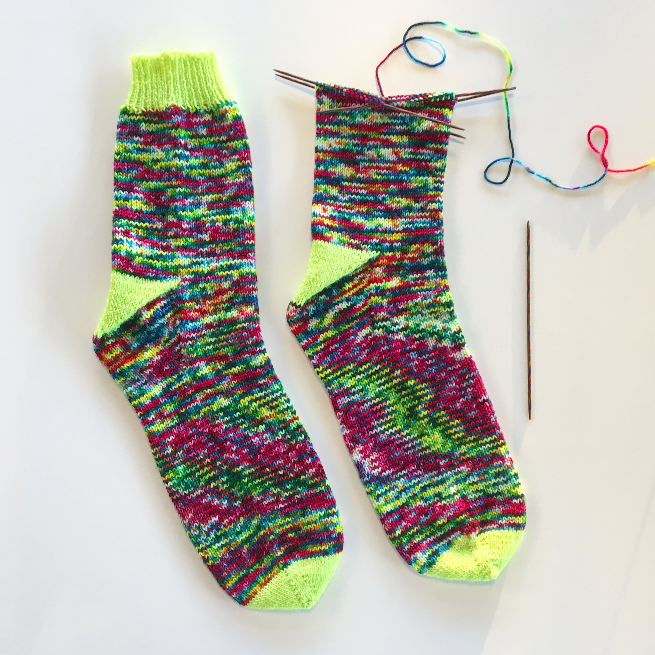 "If you want to experiment with color, you can use a contrasting yarn for the toe section, the heel turn, and the cuff as shown here in  our ""Safety Third"" sock pattern ."