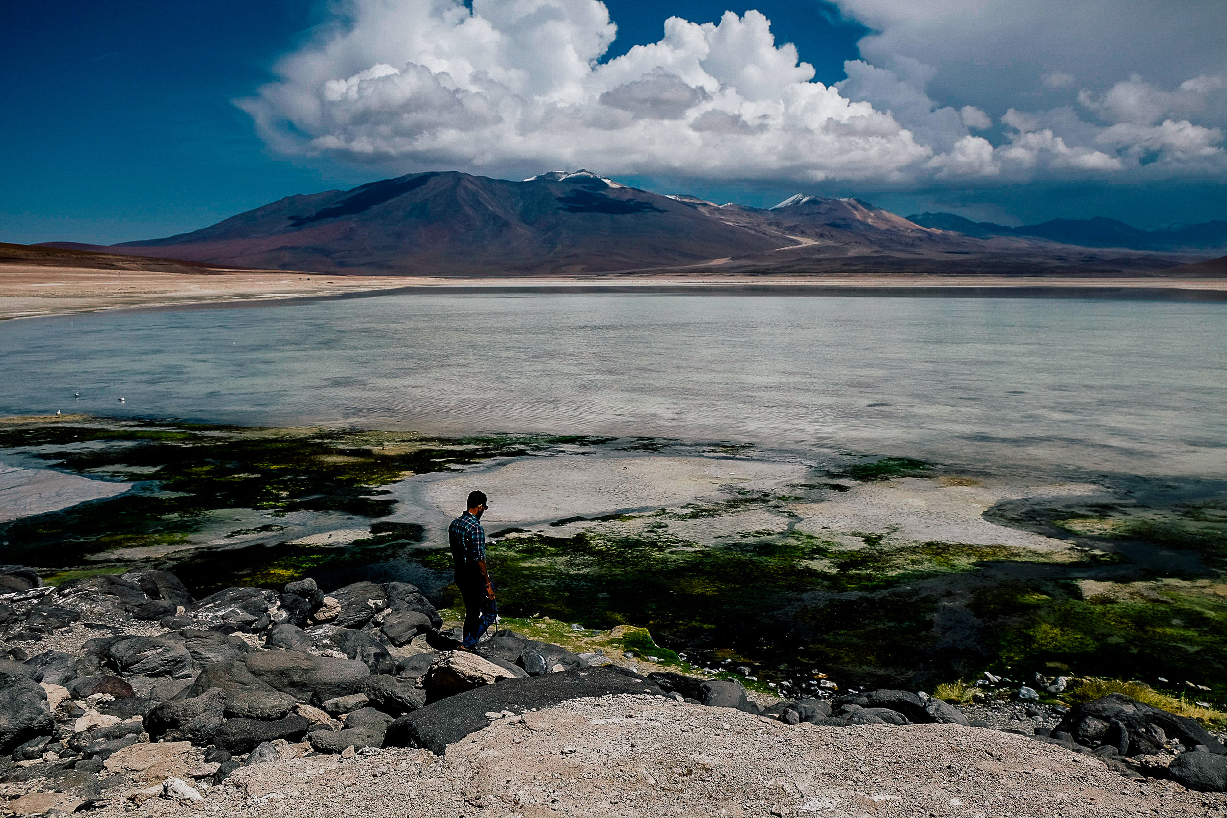 At the foot of volcano Licancabur is Laguna Verde (Green Lagoon). It has mineral suspensions of arsenic and other minerals which gives it a varying turquoise to dark emerald colour.