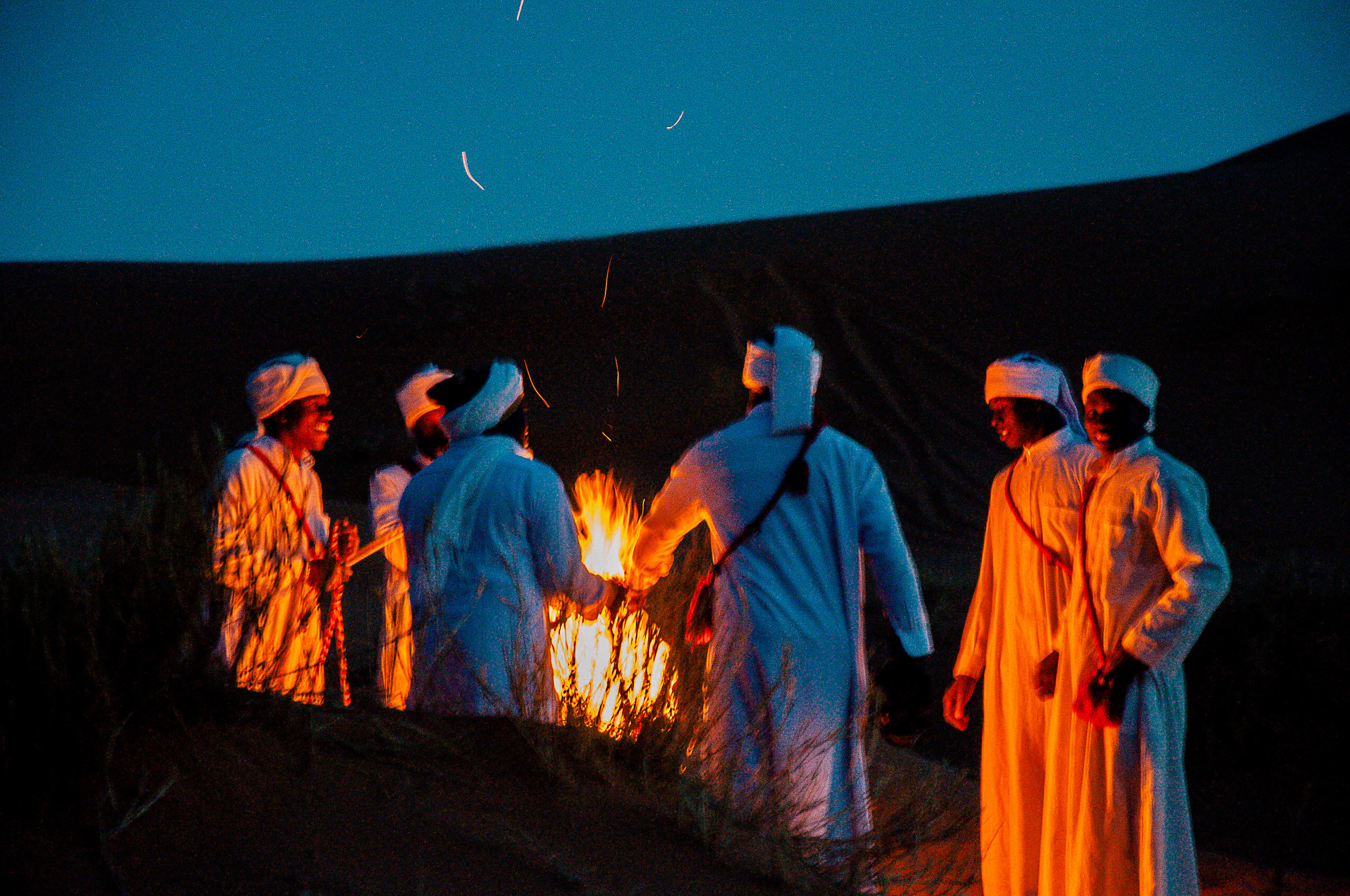 Locals performing their ceremonial activities by the fire.