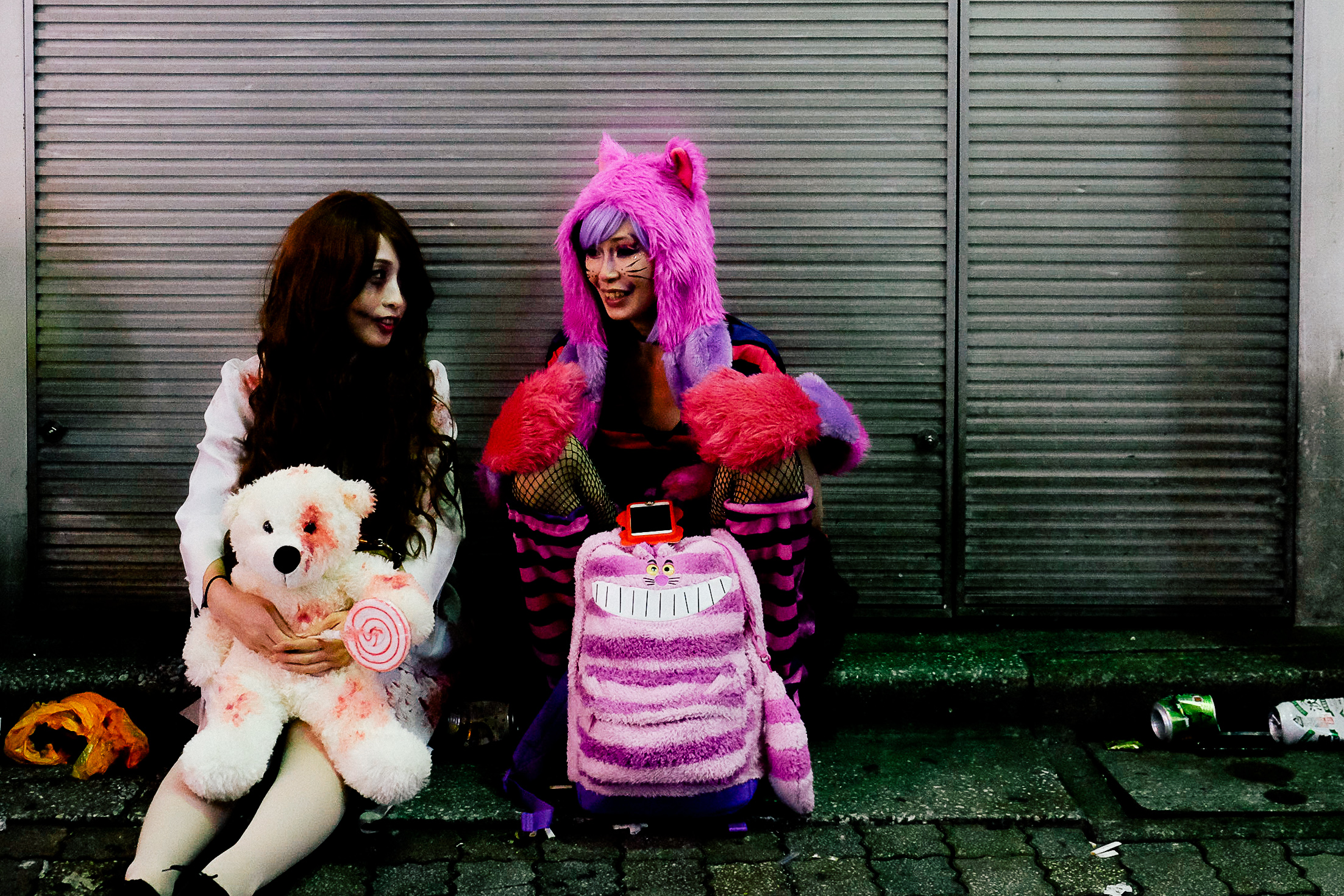 Girls wearing colourful and anime inspired costumes.
