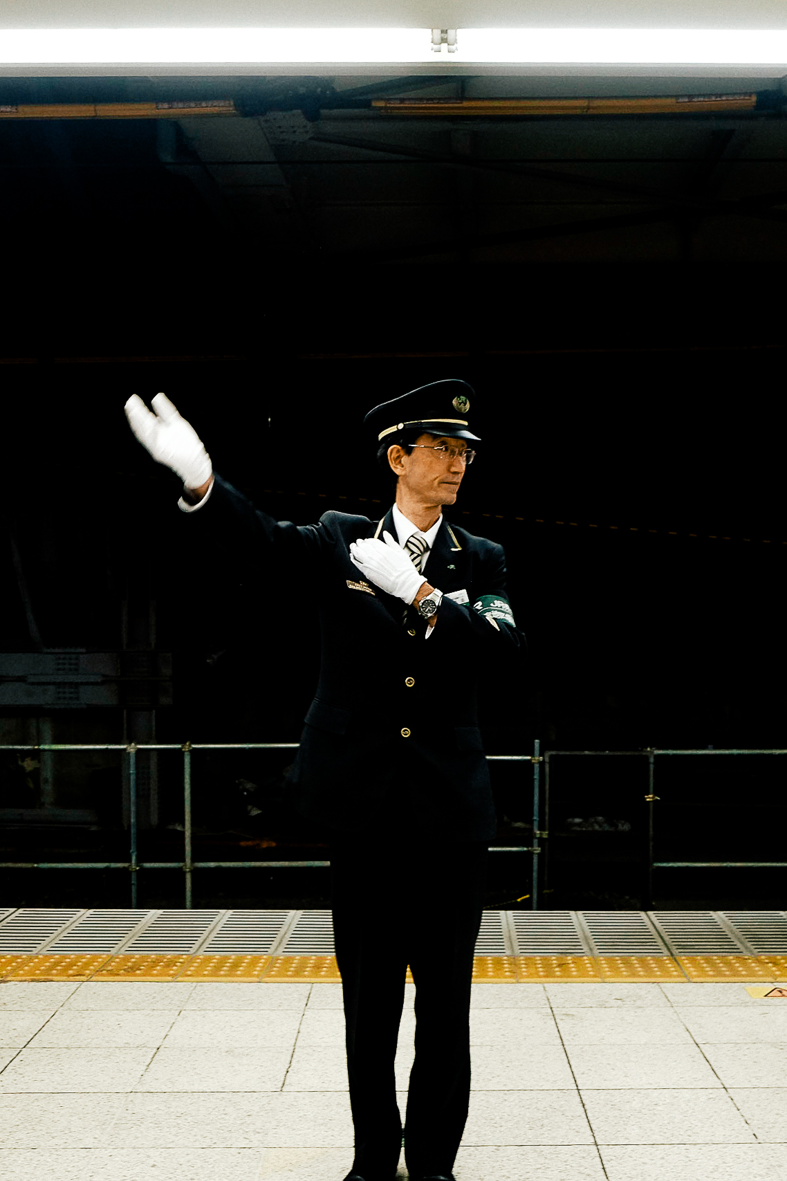 Railway officer directing the crowds.