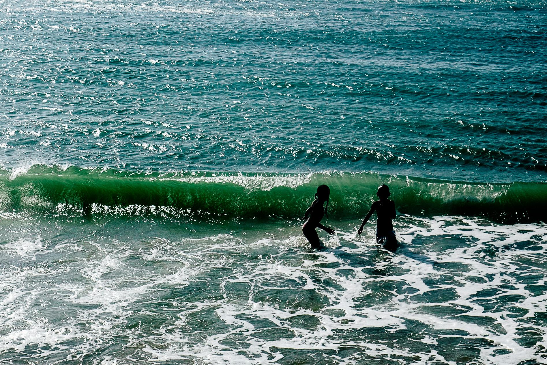 Kids jumping waves.