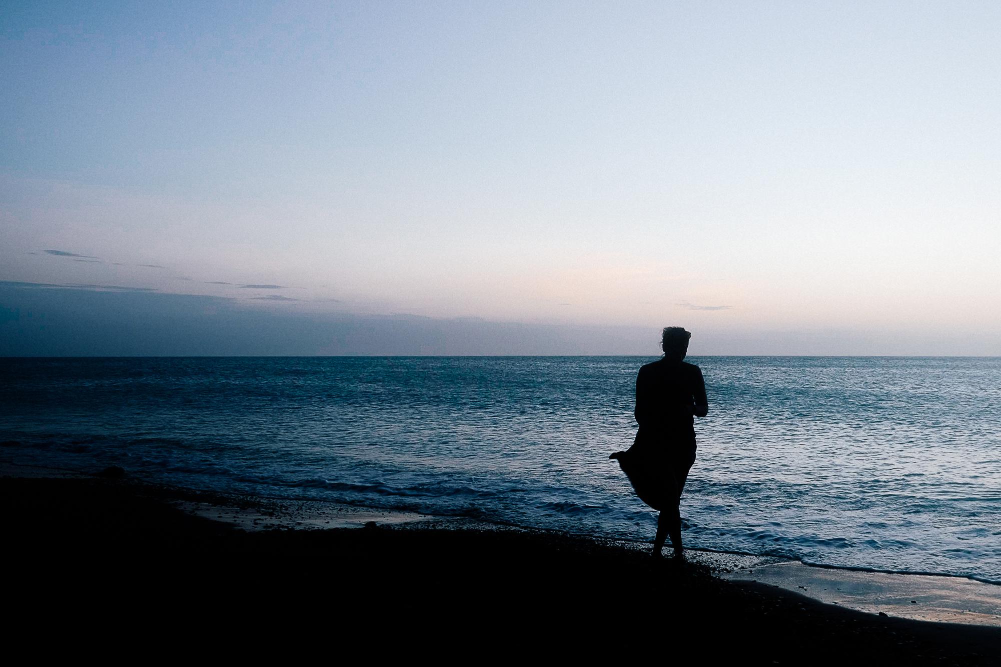 Sabrina walking the beach.