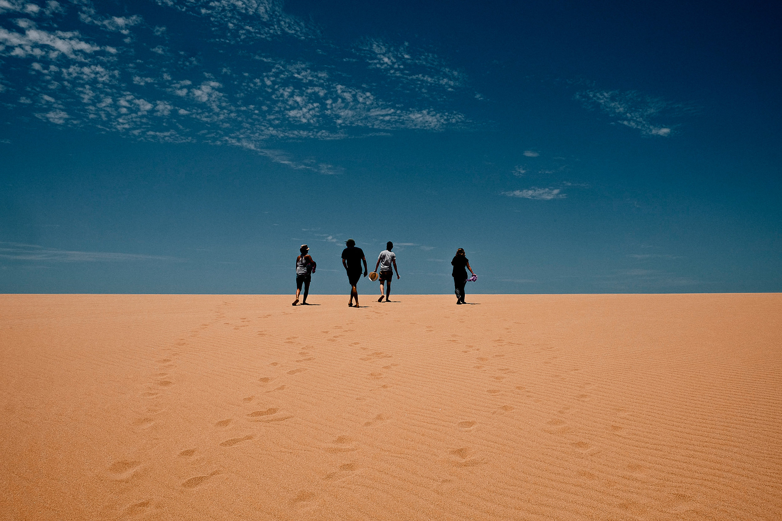 Climbing over the massive Taroa Dunes, we were not prepared to see the ocean on the other side.
