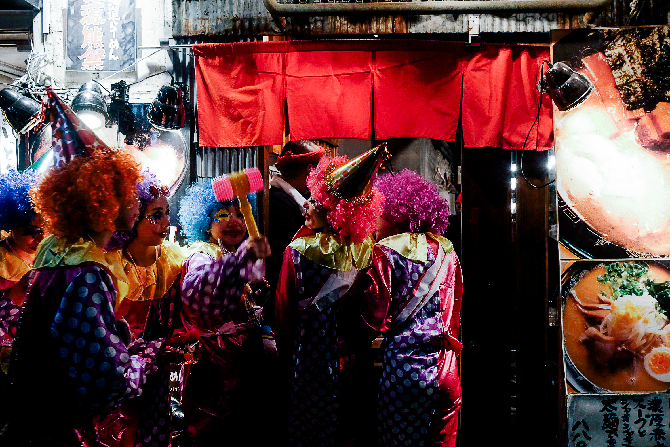 Hungry clowns lining up for a late night snack.