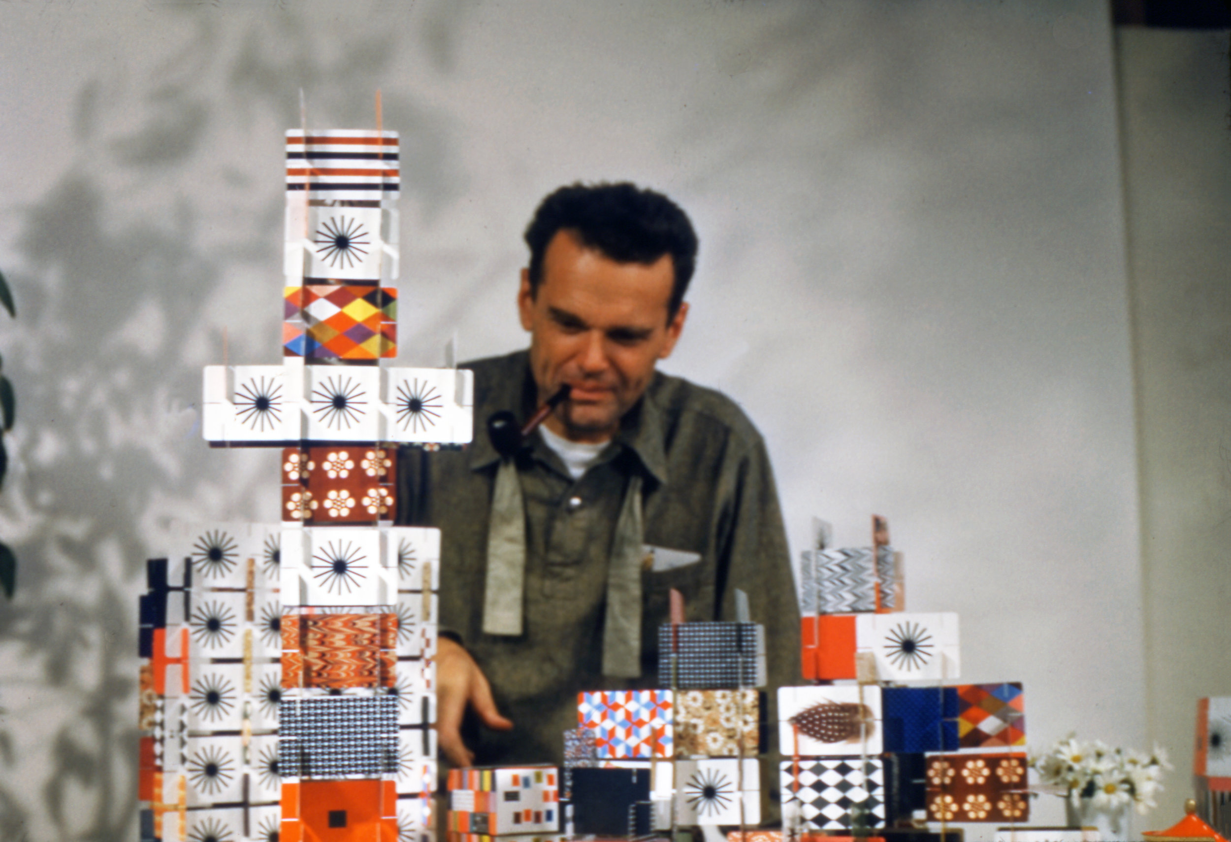 02. An Eames Celebration. Charles Eames playing with the House of Cards_Pattern Deck_1952_∏_2017 Eames Office_LLC.jpg