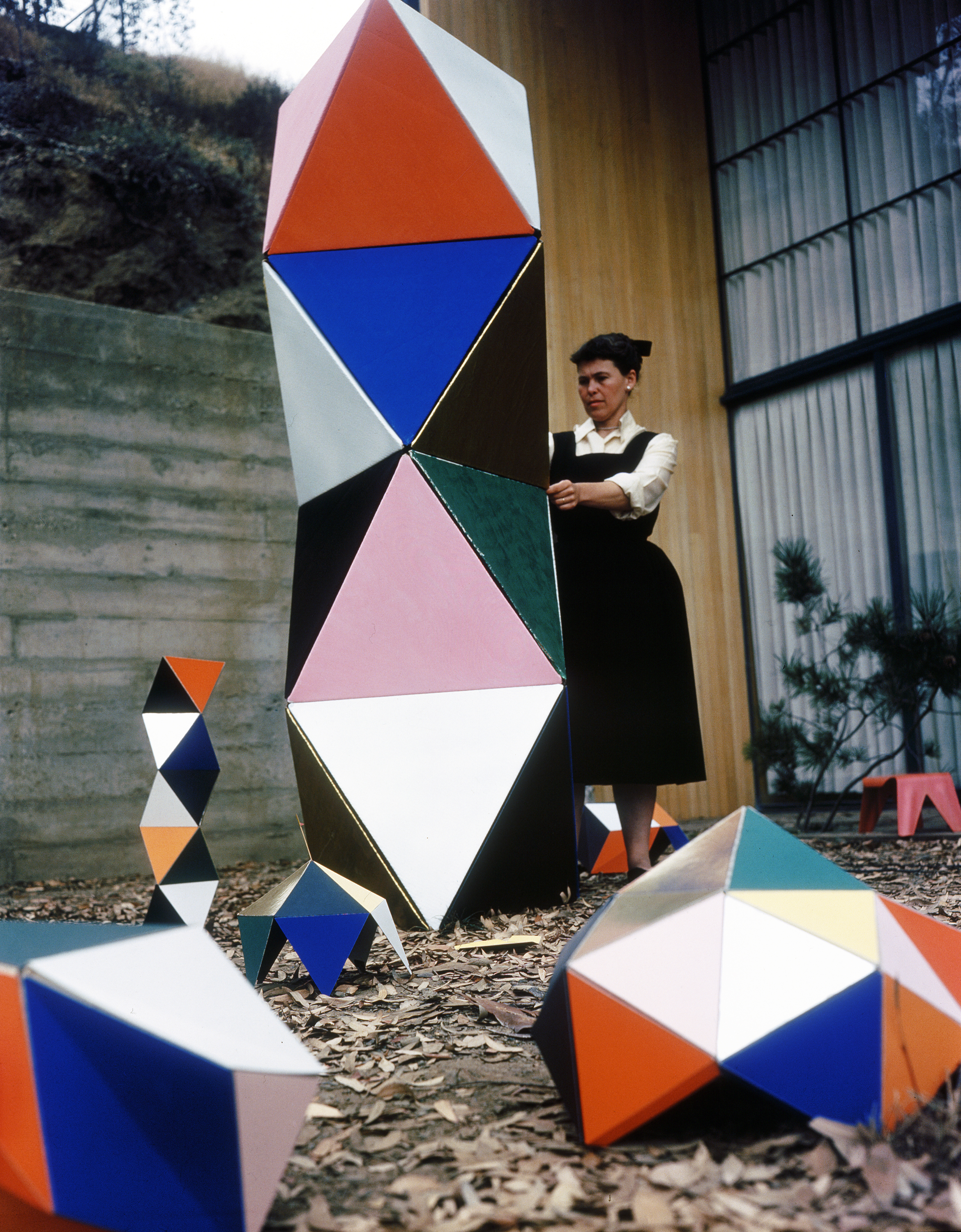 05. Ray Eames with an early prototype of The Toy in the patio of the Eames House, 1950. ∏ Eames Office LLC.jpg