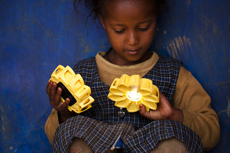Little girl playing with Little Sun in Ethiopia. Photo by Merklit Mersha