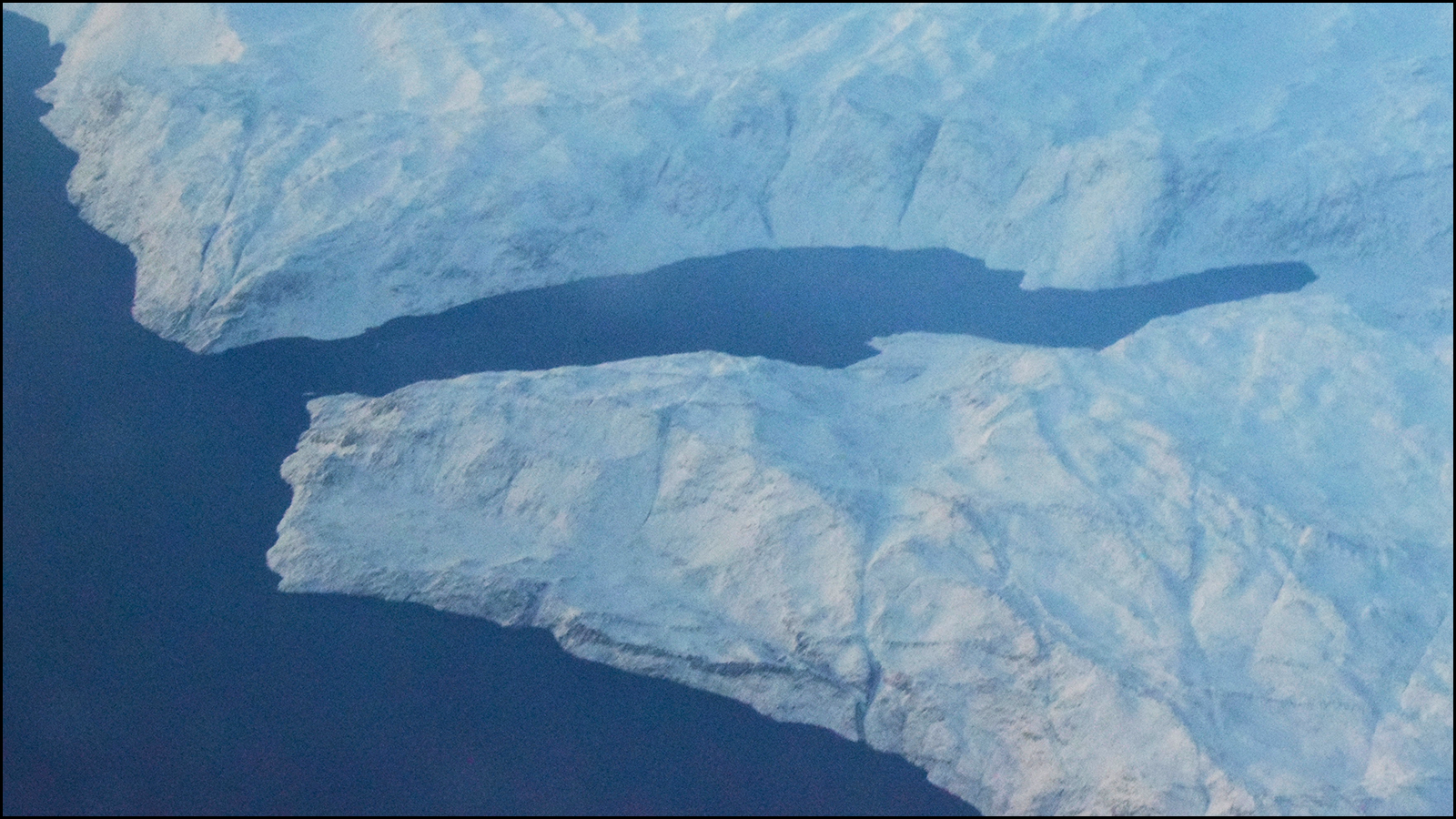 one day i will go visit greenland.  from the air, it looks magnificent (c) mark somple 2019