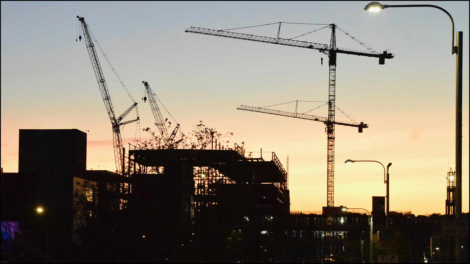 """cranes going to sleep for the night.  in the morning they build more """"stuff!""""  (c) mark somple 2019"""