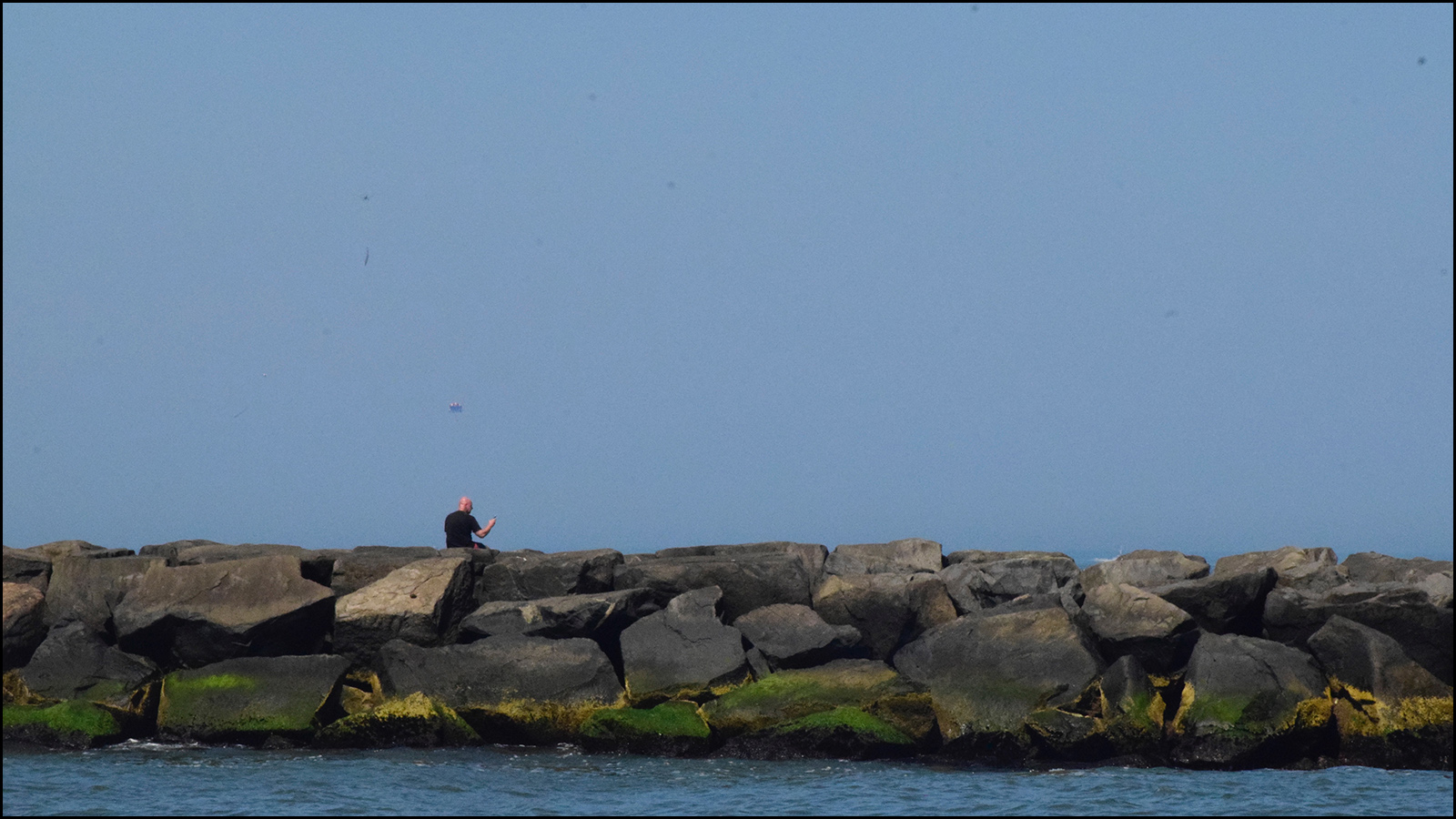 man thinking on some rocks while fishing (c) mark somple 2019