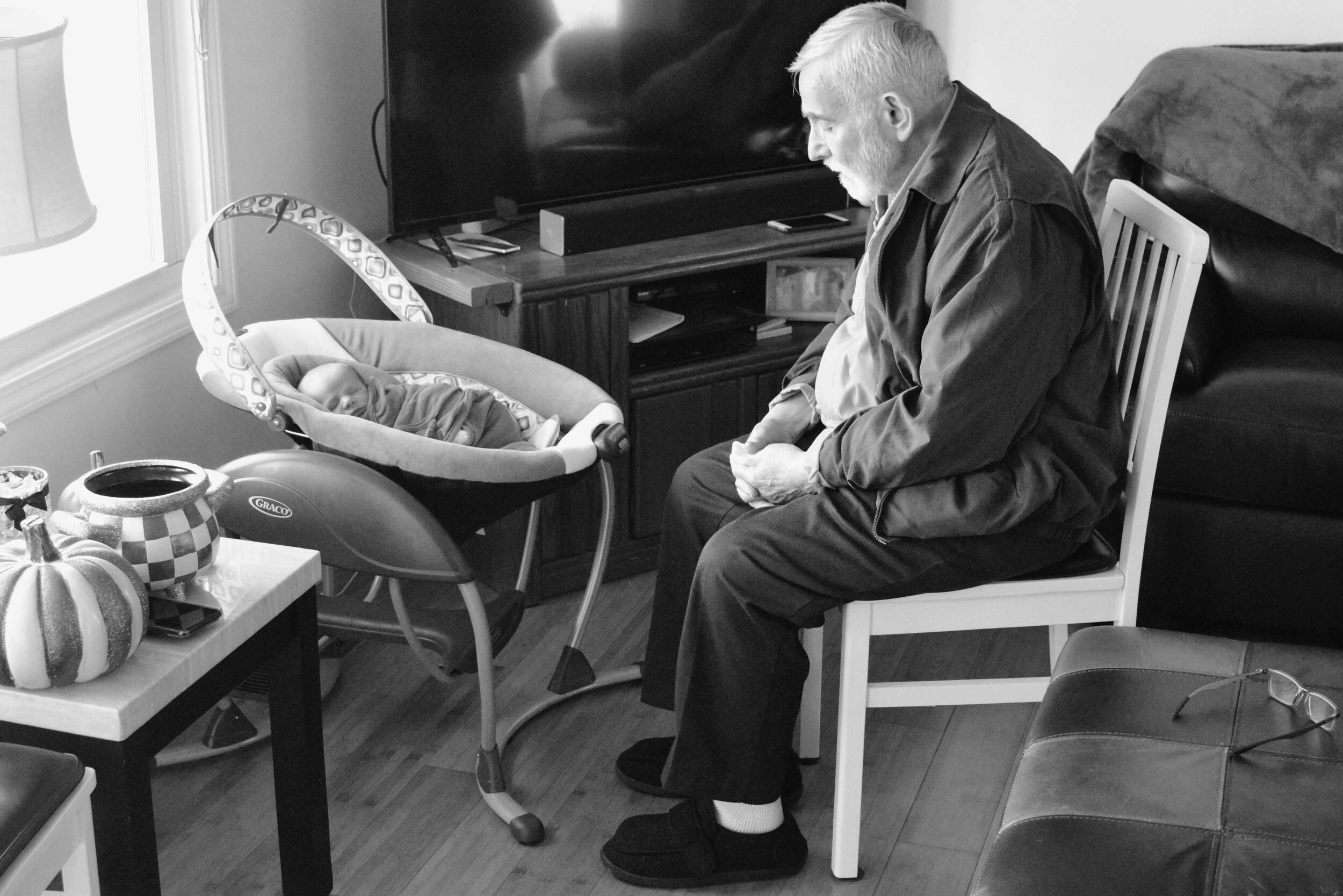 a grandfather sharing a prayer of wisdeom with his new grendson (c) mark somple 2019