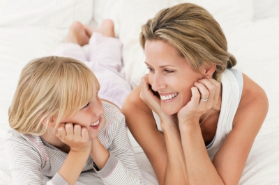Mother and Daughter Lying on A Bed.jpg