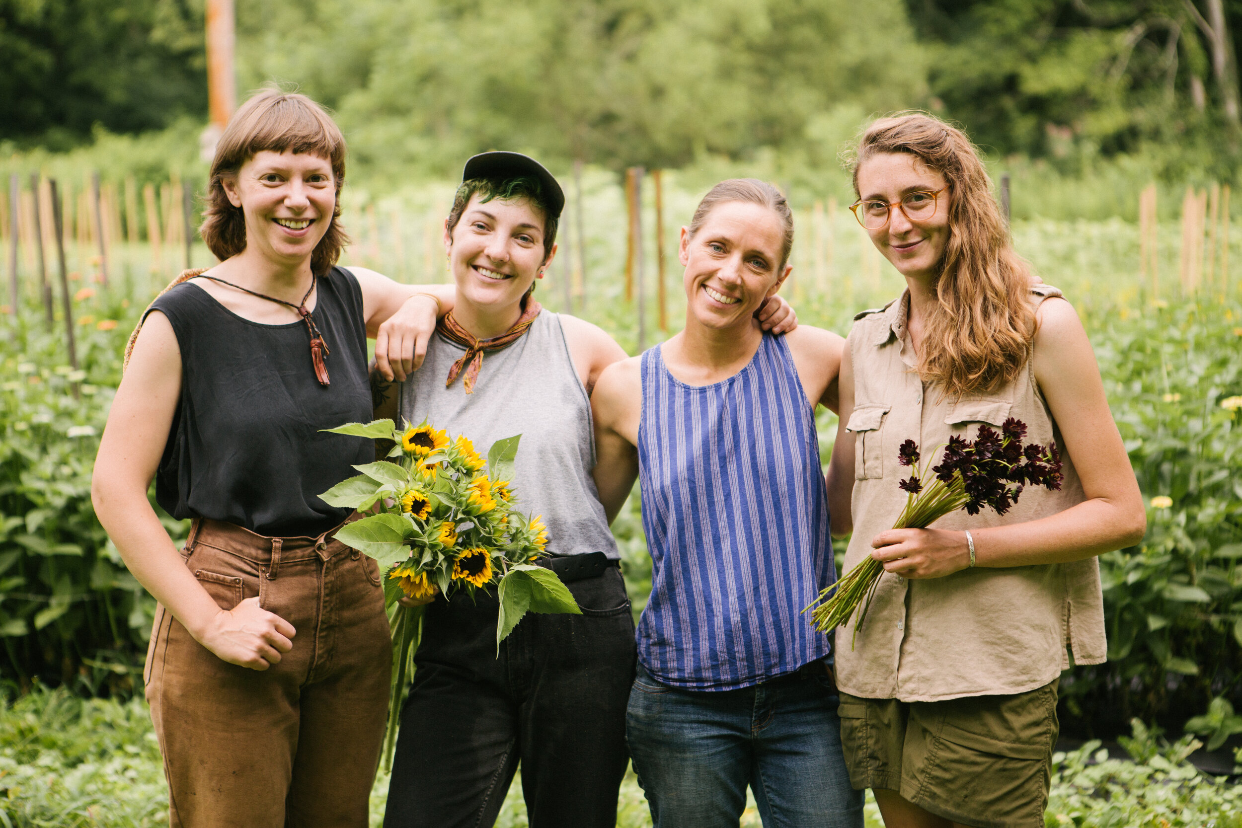 A sweet photo of our Thursday harvest team, taken from our July farm photoshoot by  Ann-Marie VanTassell .   from left, Amelia P., Samantha, Elisa, and Amelia H.