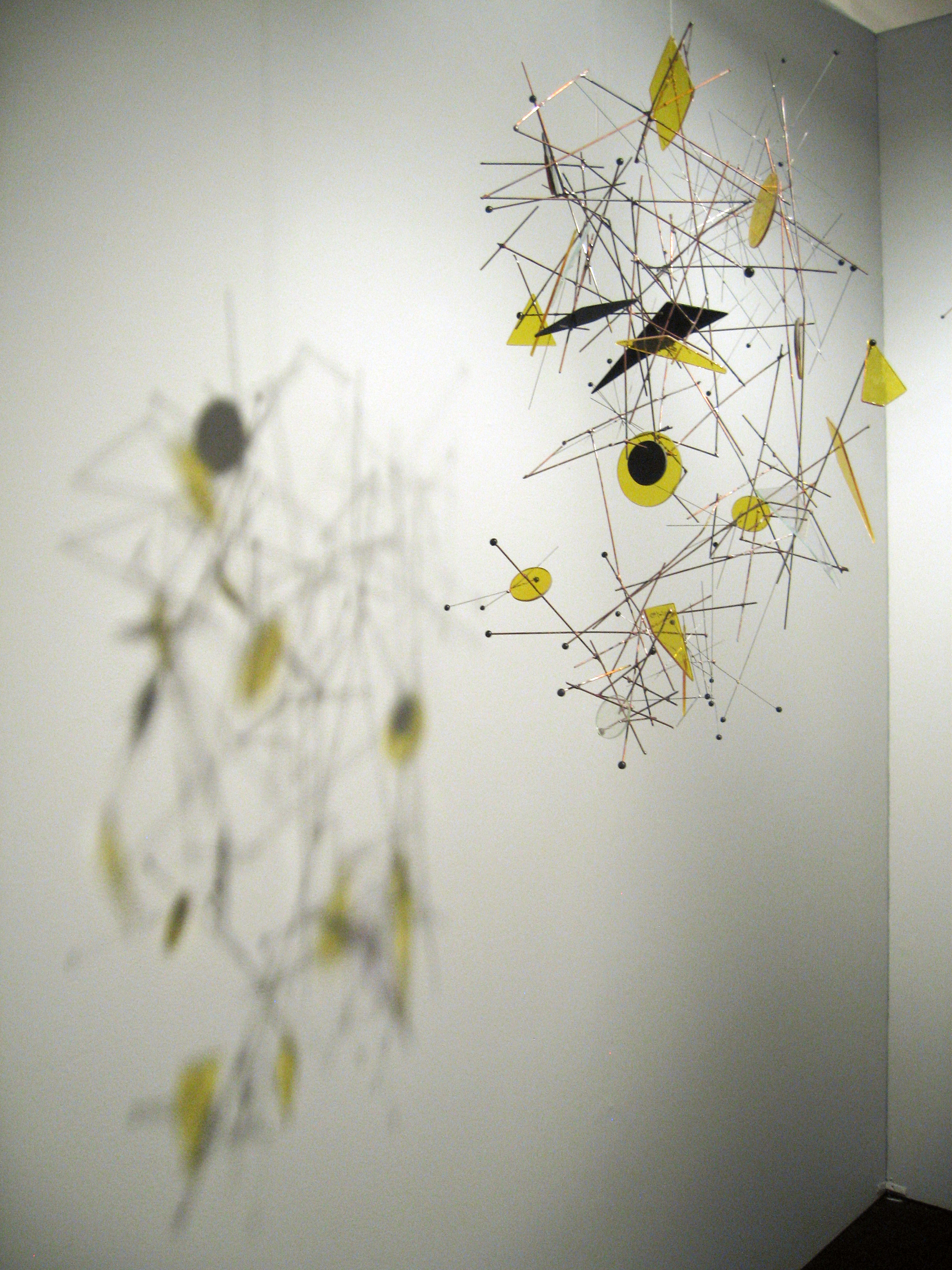 Suspended Solar City  -2010 - Wire mobile, copper, stainless steel, stained glass, and ceramic - 32 x 22 x 17 in