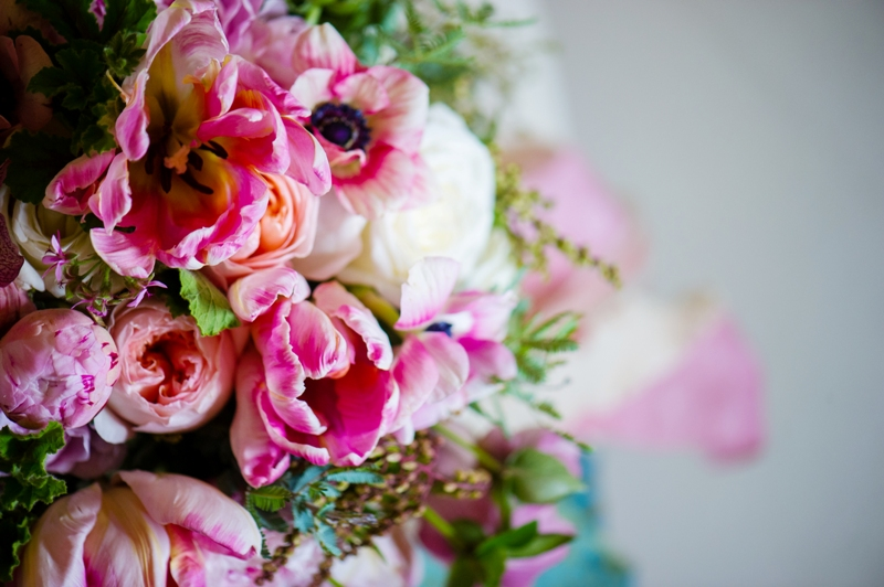 www.courtenaylambert.com - Bouquet with pink, peach, ivory, cream, and blush blooms, including Anemones, Parrot Tulips, Juliet Garden Roses, Peonies, Andromeda Pieris, Acacia, Hellebores, Beach Rose, and vintage ribbons and trims.  Created for Cincinnati Wedding Magazine by Courtenay Lambert Florals.  Flowers, Wedding florist, Cincinnati florist, Cincinnati florals, wedding bouquet, Wedding florist, bridesmaids bouquet