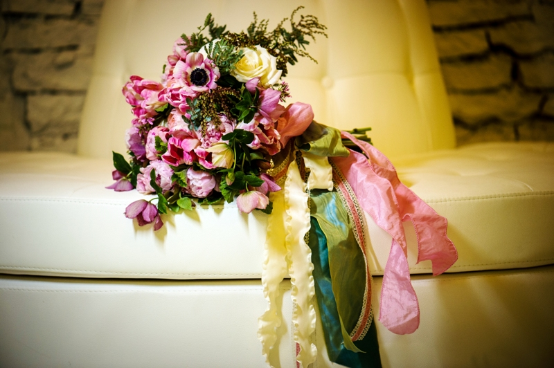 www.courtenaylambert.com - Bouquet with pink, peach, ivory, cream, and blush blooms, including Anemones, Parrot Tulips, Juliet Garden Roses, Peonies, Andromeda Pieris, Acacia, Hellebores, Beach Rose, and vintage ribbons and trims.  Created for Cincinnati Wedding Magazine by Courtenay Lambert Florals.  Flowers.