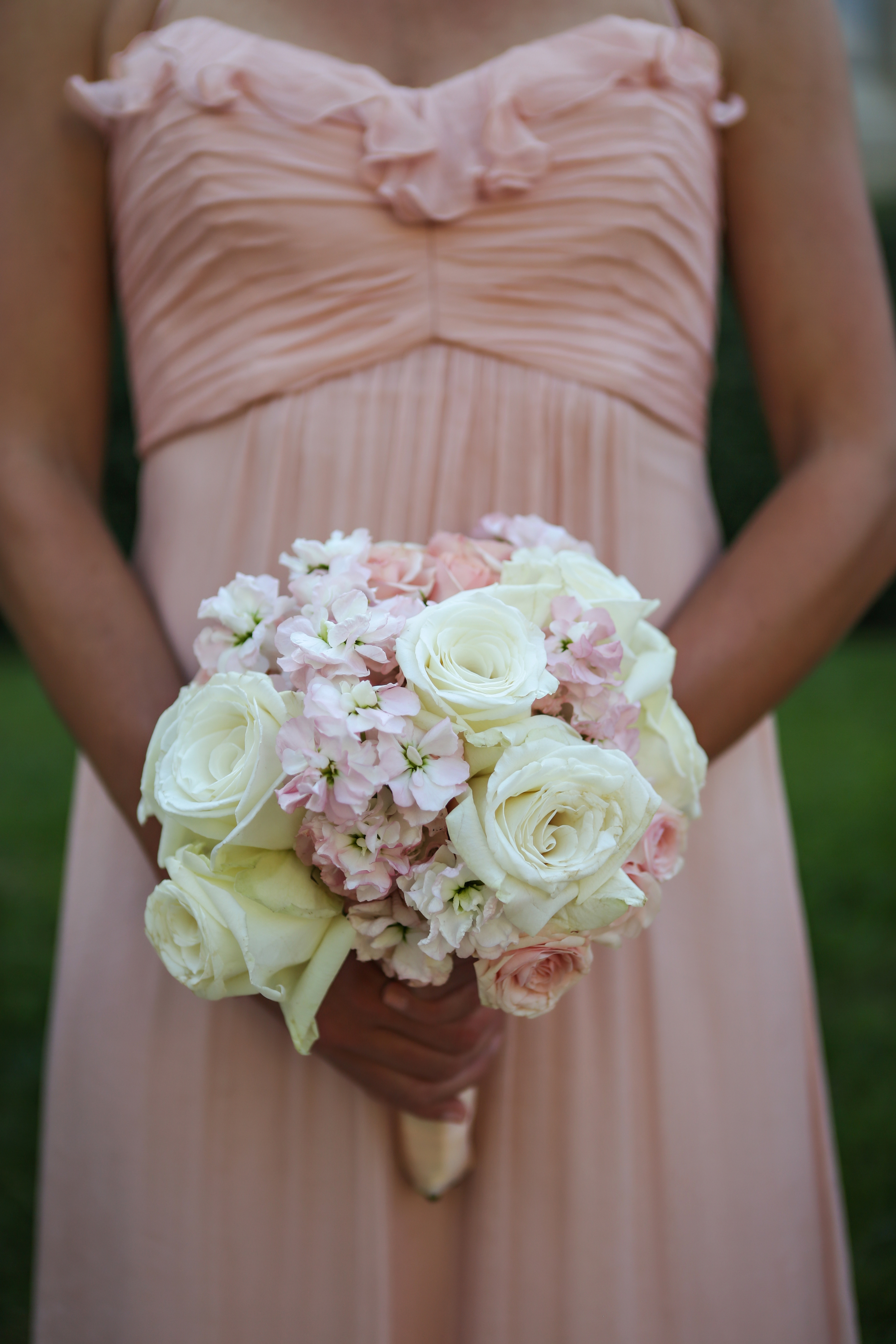 Bridesmaid bouquets complimented the wedding colors with White Dove Roses, Starblush Spray Roses, and Hydrangea.