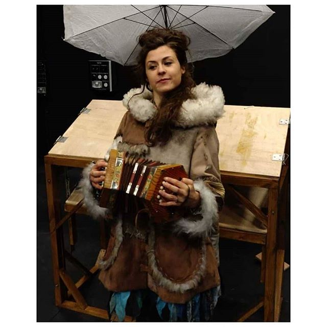 The storytelling troubadour in her custom made coat, proudly poses with the instrument she cannot for shiz. . #songwriting #storyteller #storytelling #underthefrozenmoon #fingerplacement #folk #puppetry #theatre #childrenstheatre #folkmusic #newcoat #concertina . First glimpse of the Under the Frozen Moon set by @pete_morton. Coat made by Katie Underhay . @halfastring @marlowetheatre