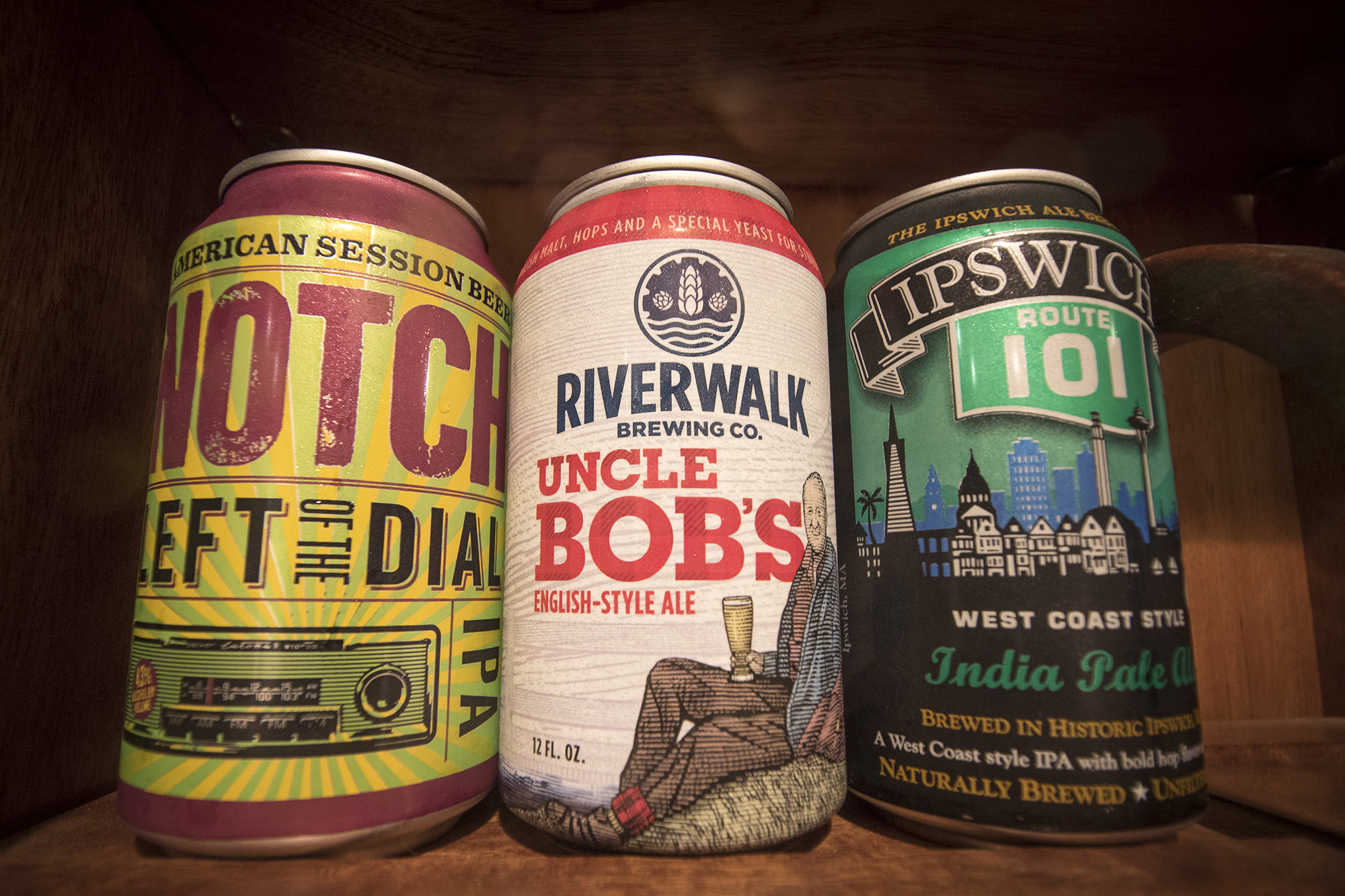 Keating is currently recommending three local beers (from left): Notch Brewing Co.'s Left of the Dial IPA, Riverwalk Brewing's Uncle Bob's English-style Ale, and Ipswich Brewing's Route 101 West Coast-style IPA. (Photograph by Jackson Mitchell)