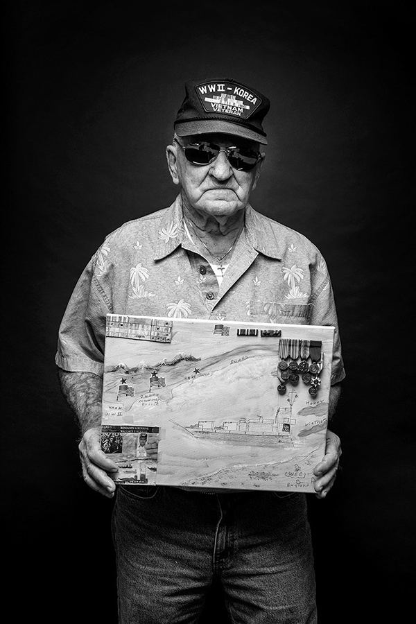 Wallace Burbine  90, Manchester | US Navy, Seaman 1st Class  Burbine left school at 12 and joined the Navy at 17, in 1943. Six months later he was aboard an LCT-A10 landing craft as it surged towards Utah Beach on D-Day, the first day of the Normandy Invasion. His job? Land on the beach and unload supplies. He would spend the next nine months crisscrossing the English Channel resupplying troops.  He returned to Boston and was discharged in 1946, but he reenlisted in 1950 and served aboard the USS  Great   Sitkin  during the Korean War. In 1954, he shifted services and joined the US Air Force, where he remained for 15 years, serving in Vietnam from 1967-68.  In 1947, his parents and siblings moved to Gloucester. His father, Edmund, a fisherman, was lost at sea in 1959. In 1960, he met and married Dorothy Jerome, an elder care nurse. After a number of years on military rotation, the couple settled in Manchester in 1969, where they have lived ever since.  Since his retirement, Burbine has enjoyed drawing and painting. He is holding his rendition of the Invasion of Normandy.
