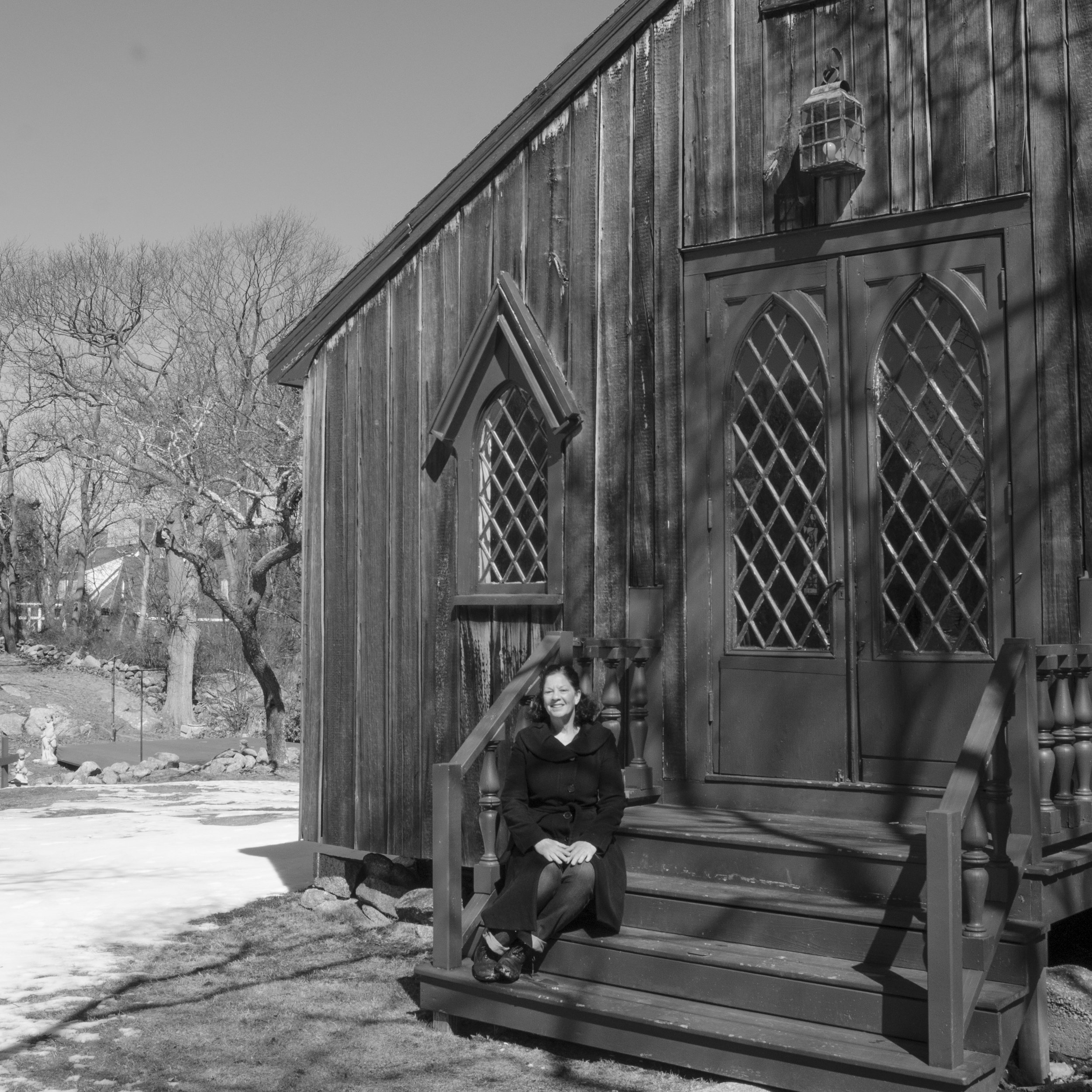 """Lisa Hahn, executive director of the Windhover Center for the Performing Arts, on the steps of """"The Chapel."""" (Photograph by Eoin Vincent)"""