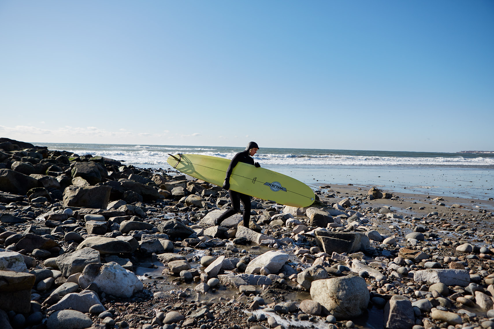 Canniff about to test the waters at Rockport's Cape Hedge beach. (Photograph by Jonathan Kozowyk)