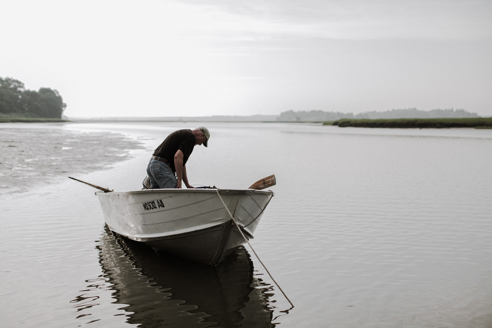 """""""My part is digging the clam, measuring it and bringing it to my boat."""" (Photograph by Matt Kalinowski)"""