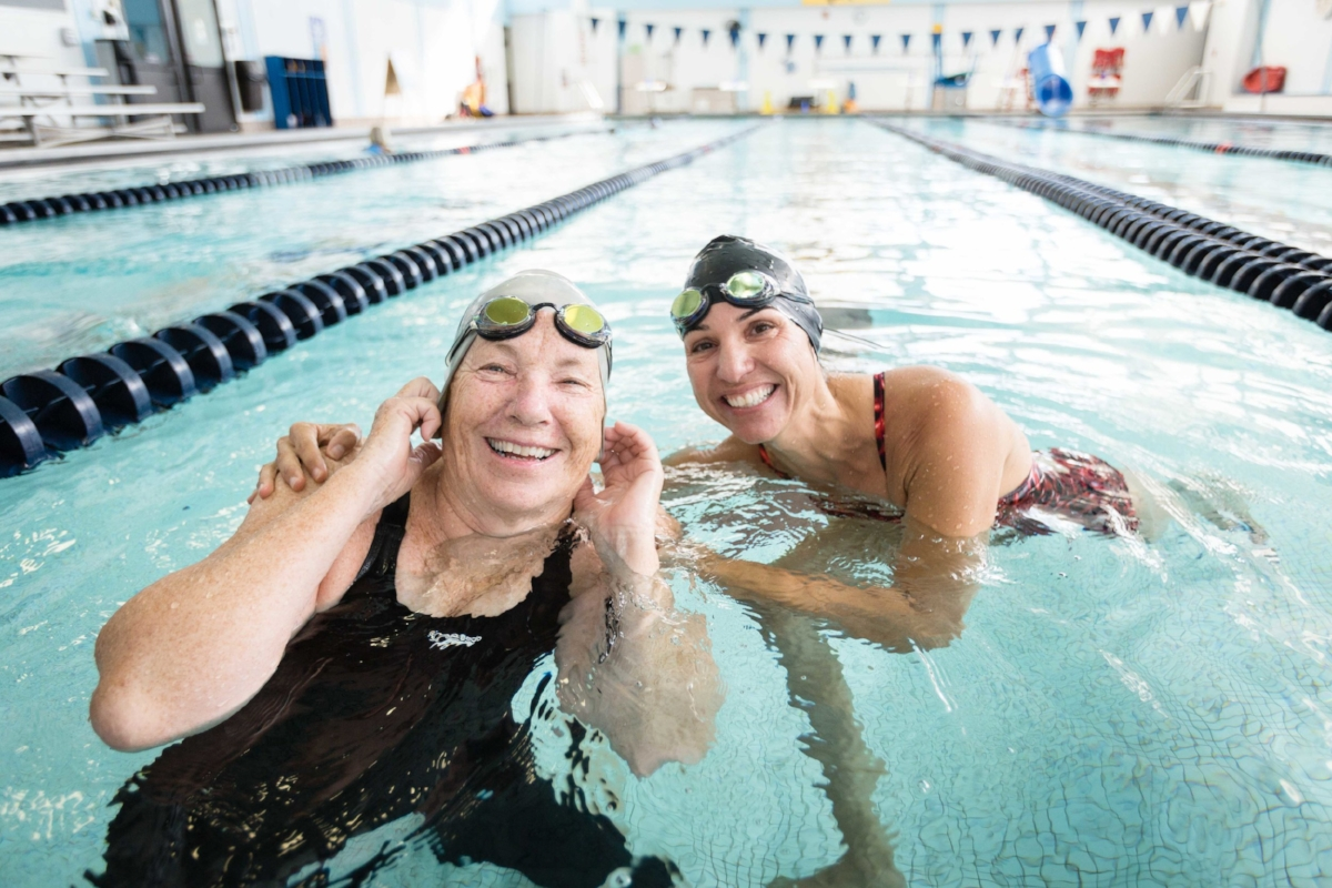 """""""Kathy is one of the strongest and most dedicated swimmers I know, while being the most humble,"""" says her teammate Lisa Zarket (right).(Photograph by Jason Grow)"""