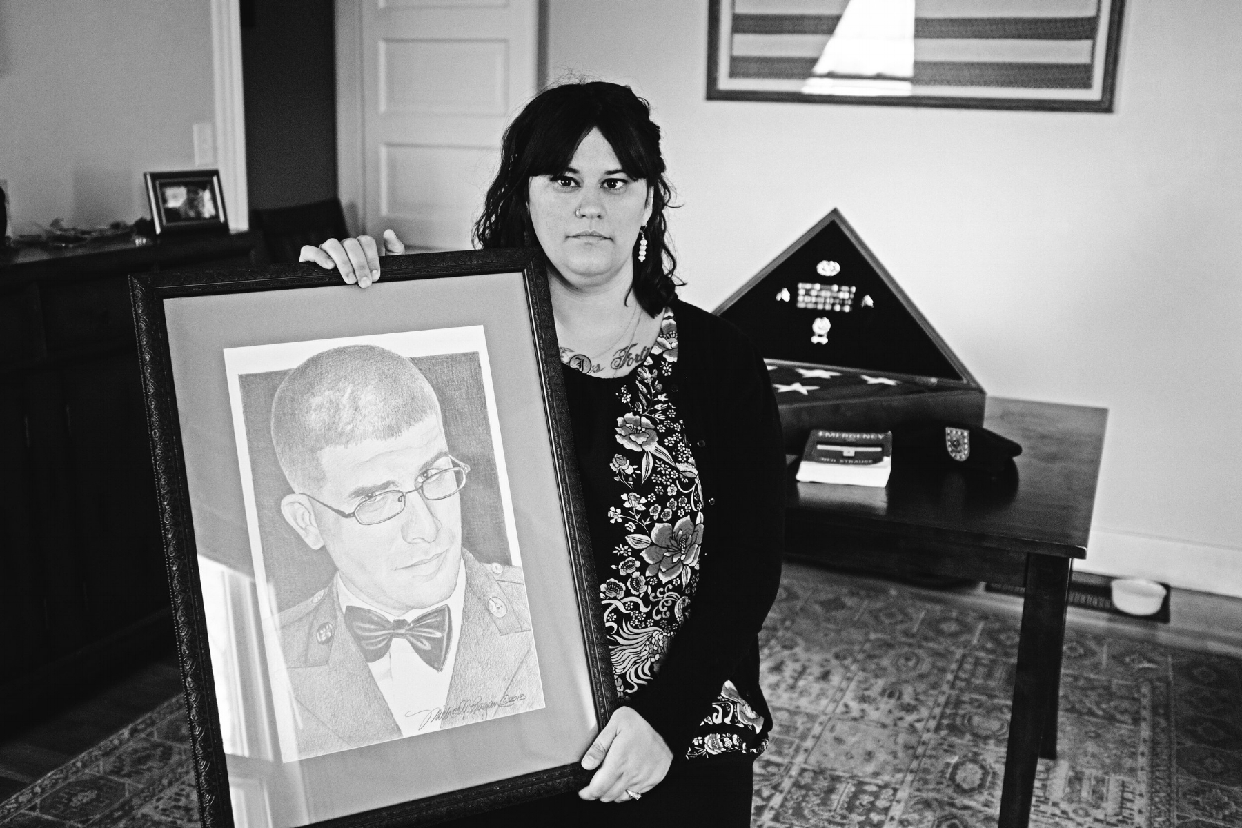 One of Lauren's favorite images of James is a portrait done by Michael Reagan of the Fallen Heroes Project. Michael immortalizes the fallen in portraits he gives to their families. (Photograph by Thi Linh Wernau)