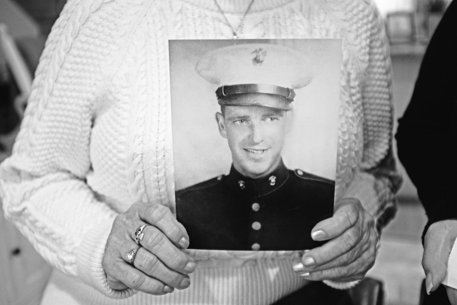 Judi Greely holds a photo of her father, Ralph, who died in World War II. (Photograph by Thi Linh Wernau)