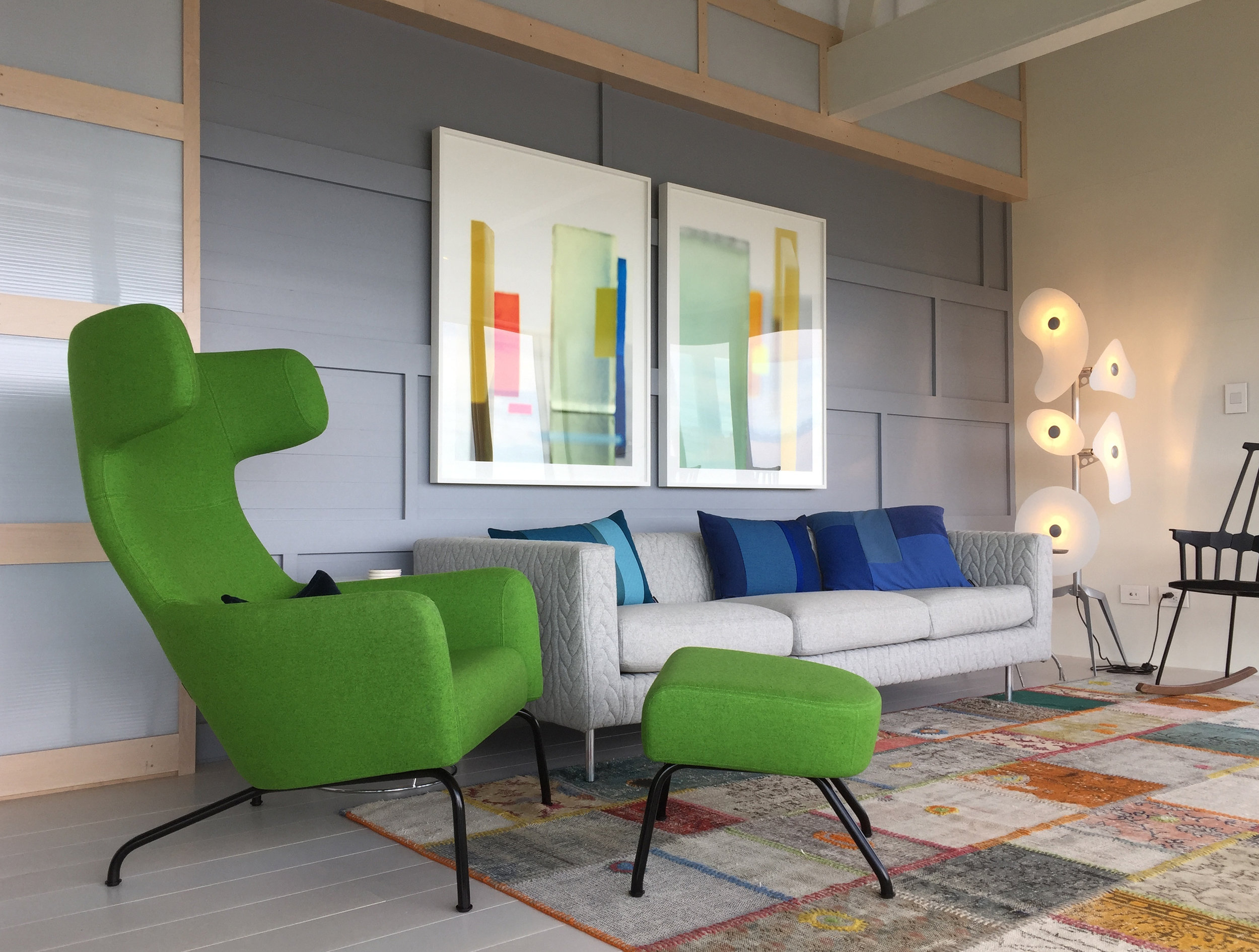 The living room is furnished with contemporary pieces in bright colors. (Photograph by Chris Becker)
