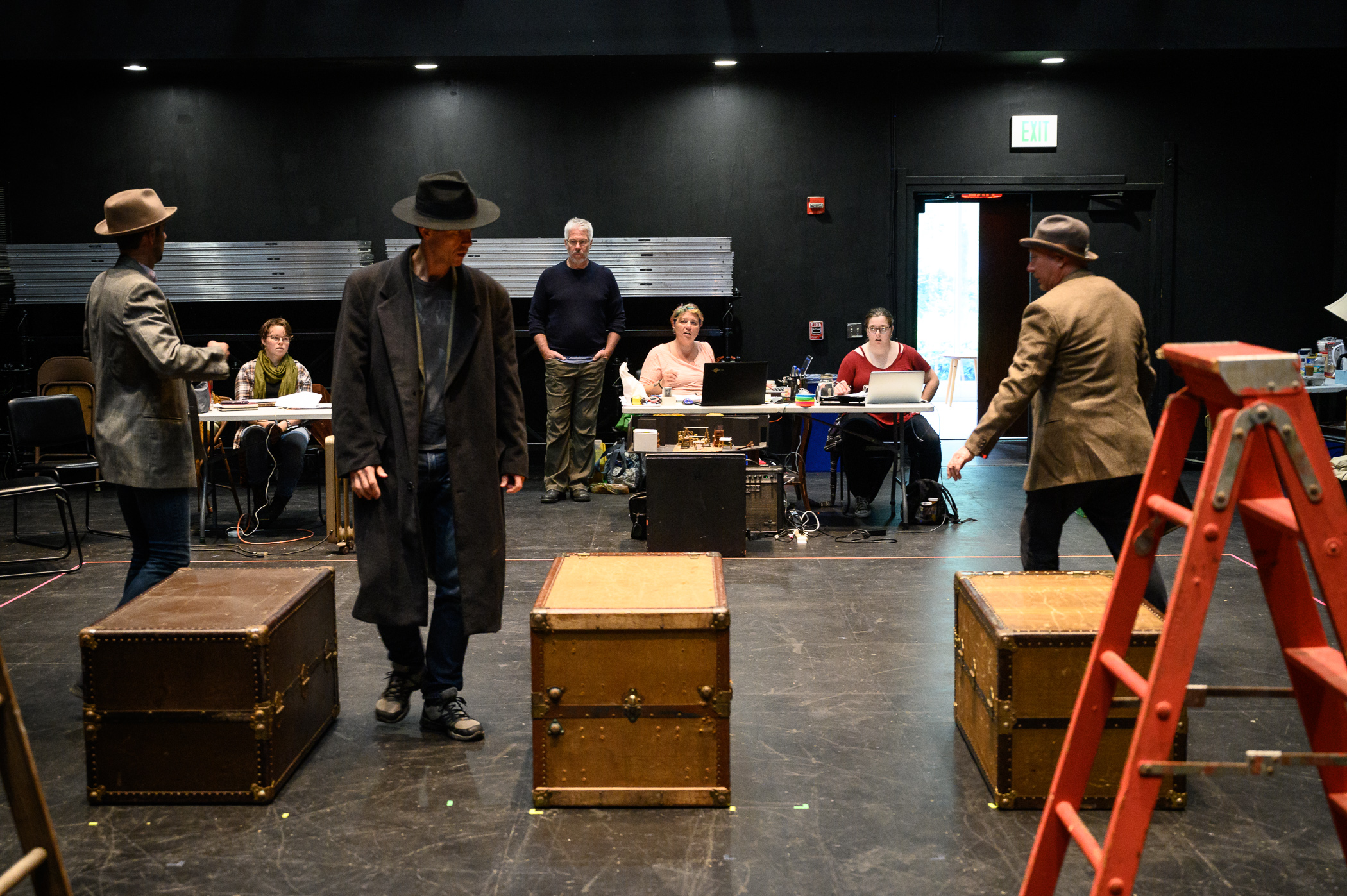 Walsh (center background, standing) directing a rehearsal of  The 39 Steps , running in July at the Gloucester Stage Company.(Photograph by Shawn Henry)